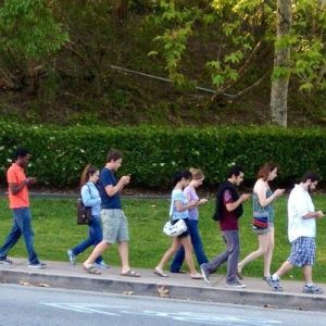 group-of-people-walking-and-texting